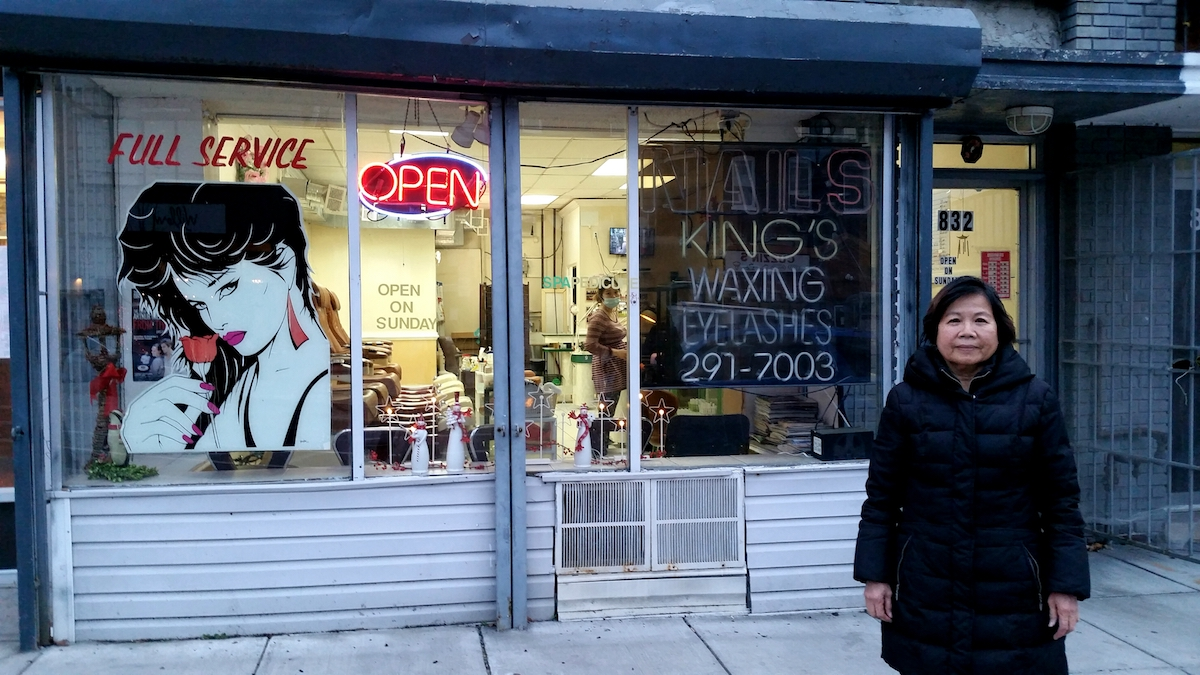 King's Nails owner Hoanh Thi Pham standing outside her store.