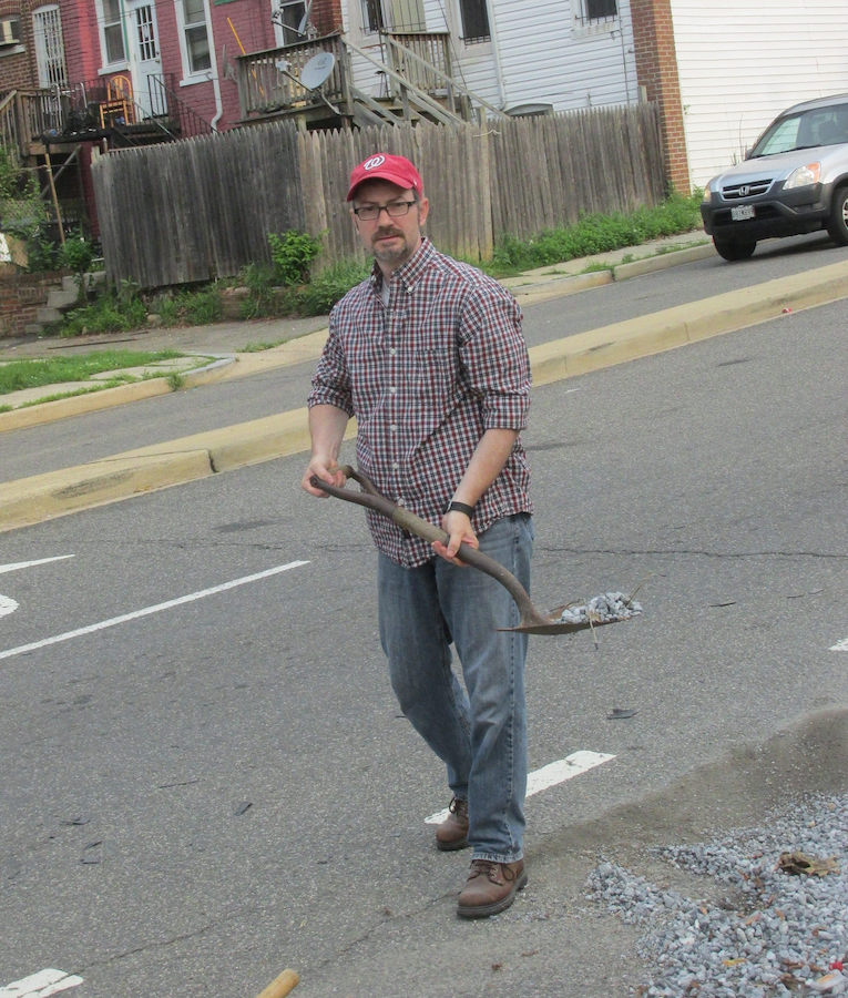 Clearing gravel from Warder Street Bike Lane