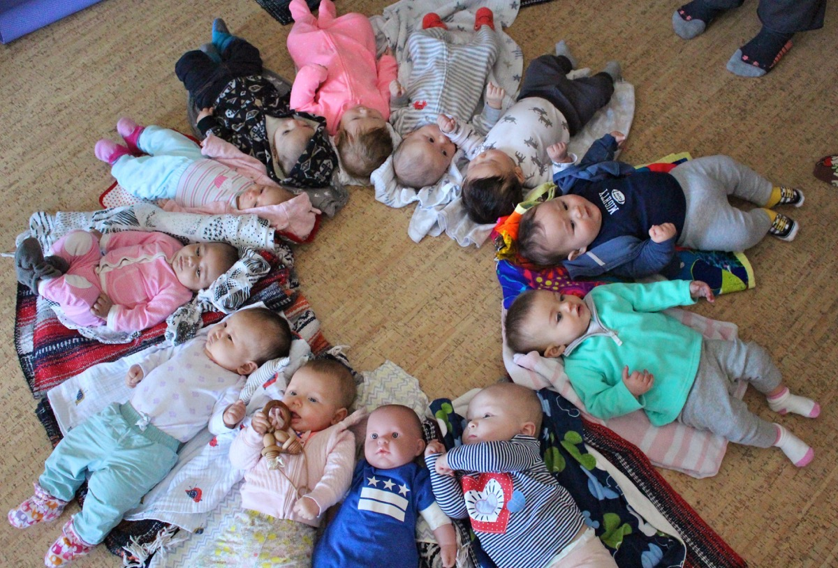 A circle of babies getting ready for yoga