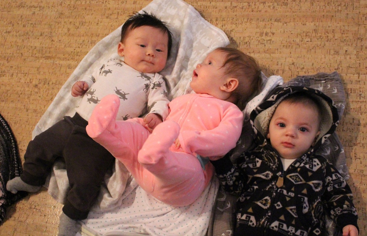 Babies get a little post-class bonding time. From L to R: Max, Claire, and Shay