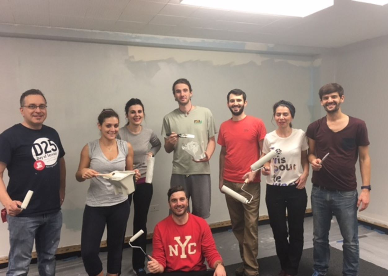 Volunteers, including Ambassador from the Republic of Kosovo Vlora Çitaku, prepare DC Community Carrot offices. (photo: David Sheon)