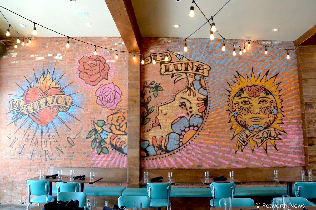 Artwork by local DC artist Matthew McMillan adorns the walls.