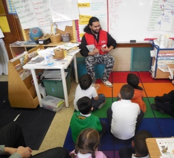 Marvin Mancia, Assistant Manager at Annie's Ace Hardware, reads to students at Powell Elementary