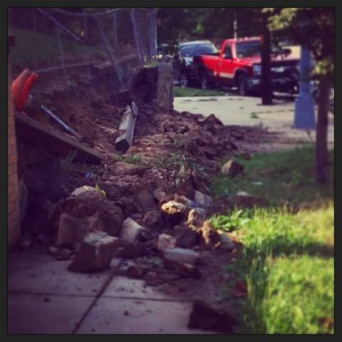 A collapsed retaining wall at Illinois Ave and 8th Street