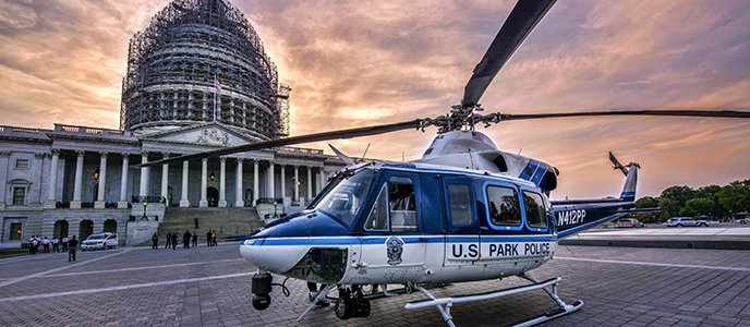 "The United States Park Police helicopter ""Eagle 2"" near the United States Capitol Building. (Courtesy NPS / R. MULLER)"