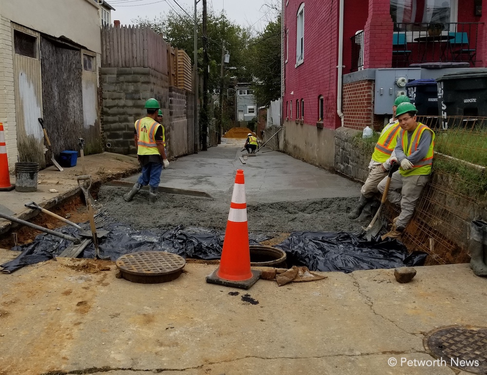 DDOT contractors work on the alley off of Upshur and 7th Street NW
