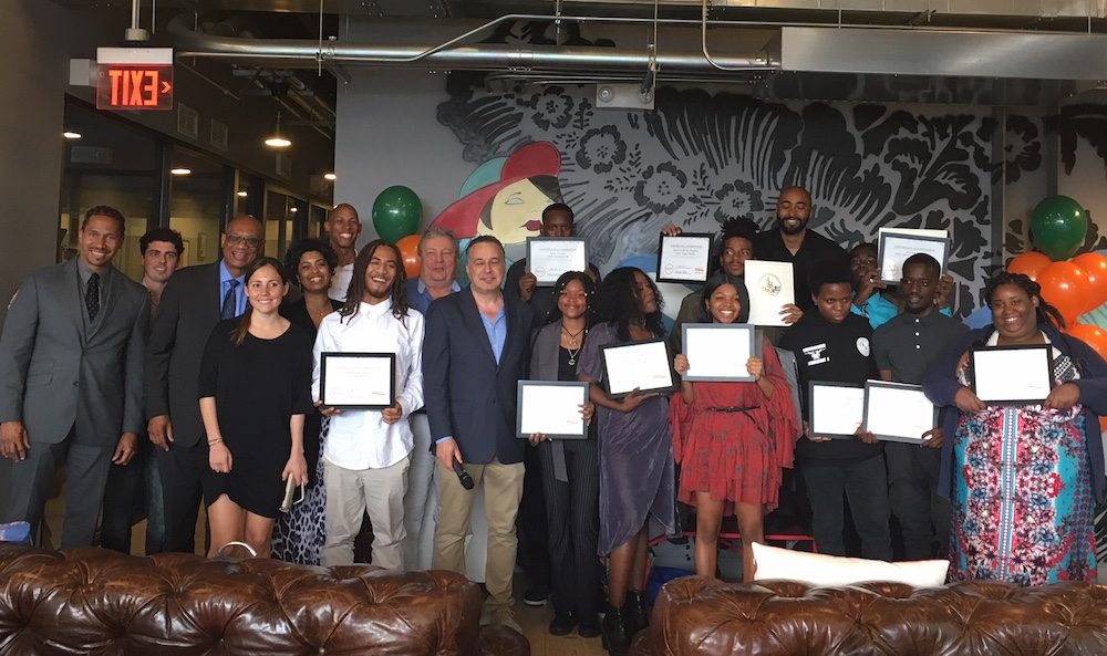 Community Carrot's new youth CEOs celebrate with Board members and staff at their recent graduation.