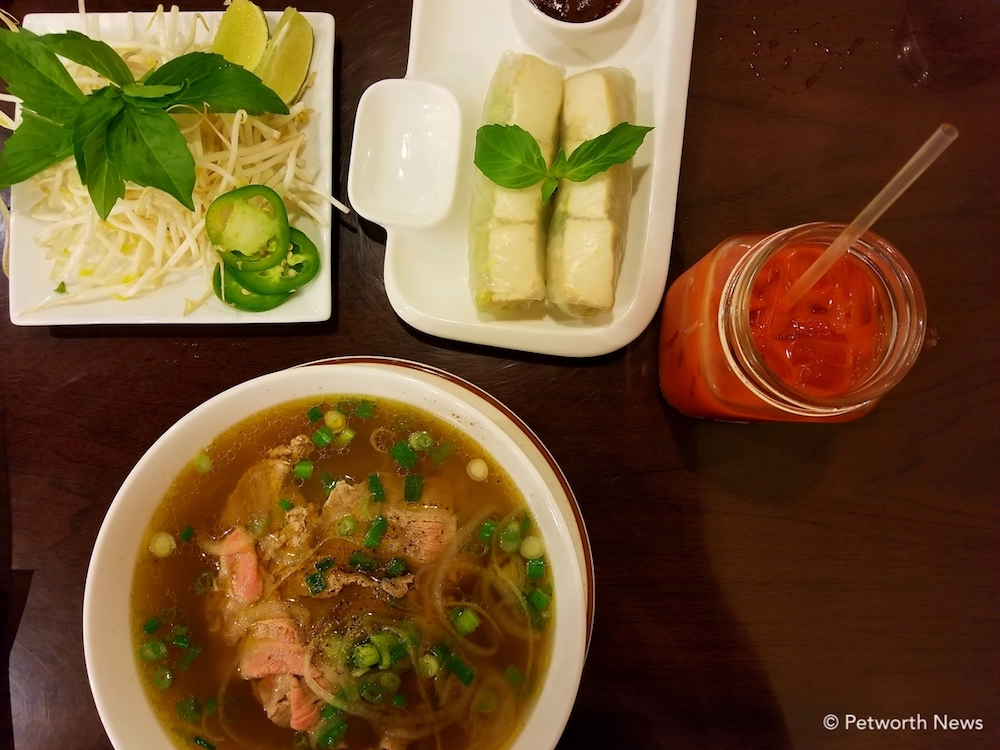 Beef pho with spring rolls and a Vietnamese ice tea