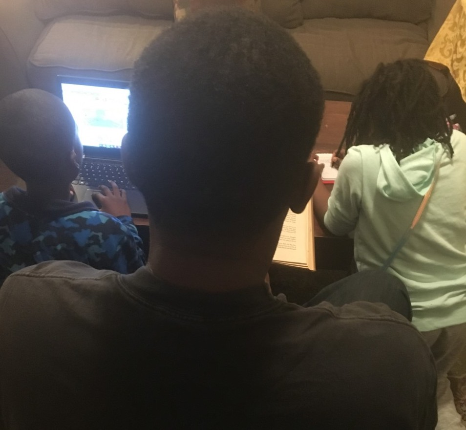 Young children studying.