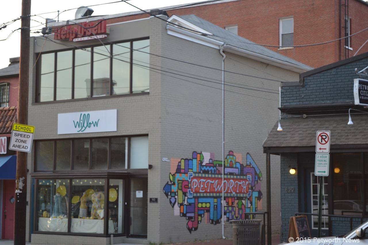 The building at 843 Upshur Street has become famous for the Petworth mural and Willow Fashion, along with the Help-U-Sell Brokerage upstairs.