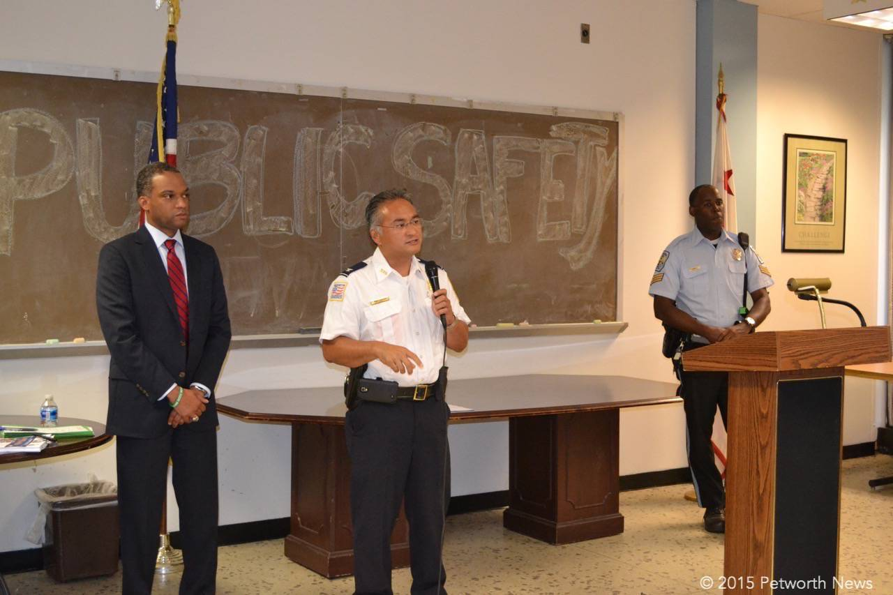 Newly promoted Assistant Chief Wilfredo Manlapaz speaking at a public safety meeting in 2015 with Ward 4 Councilmember Brandon Todd.