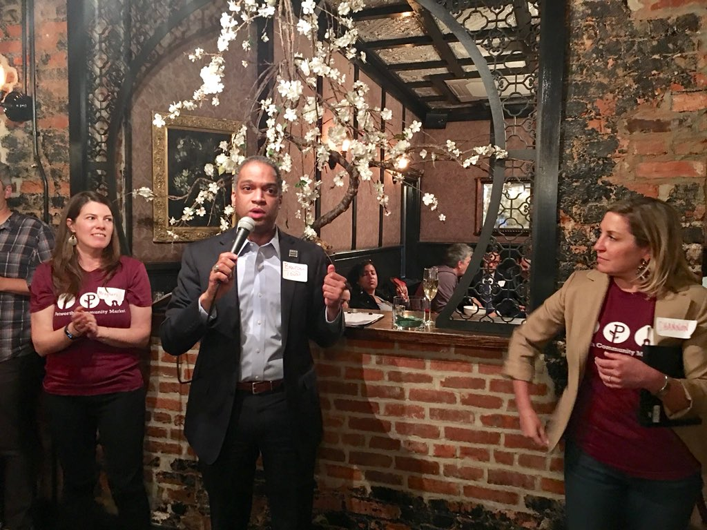 Ward 4 Councilmember Brandon Todd announcing the new DDOT policy at the Petworth Farmers' Market fundraiser on April 23, 2018.