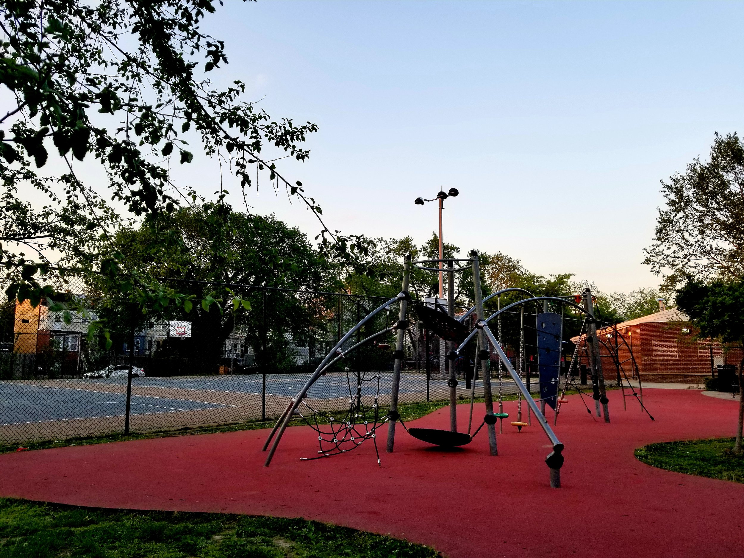 An uncrowded Petworth Park on a recent evening. Residents say the playground is popular; the basketball courts, not so much.