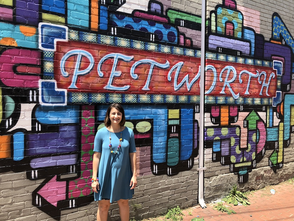 Amy Hemingway, ANC 4D06 Commissioner poses at the Petworth mural.