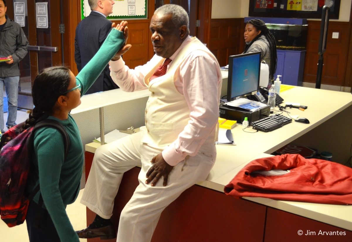 Ted Hinton greets a student during the last week of school, his last with the school system.