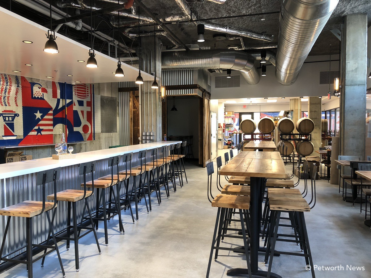 A wrap-around bar, high and low top tables and a shuffleboard table.