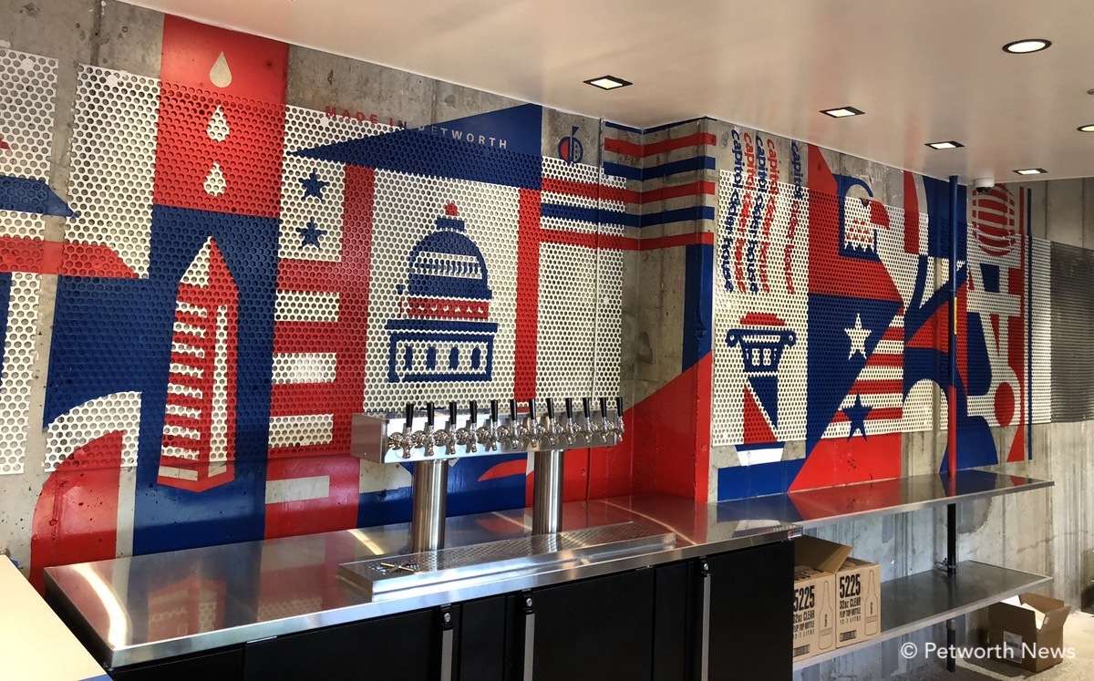 The original mural behind the bar was hand-painted by No Kings Collective.