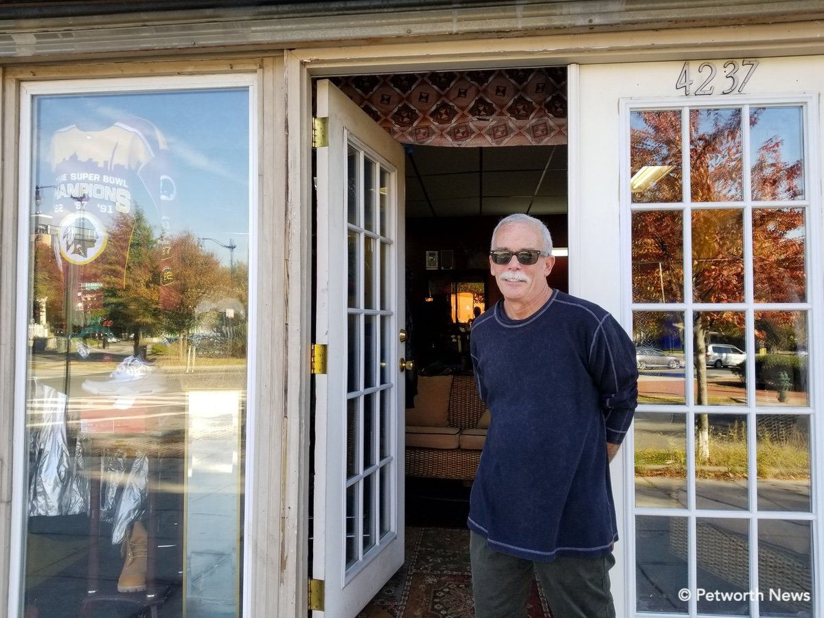 """Cathedral Property Partners co-owner Robbie Leibner in front of the soon to be open """"On Consignment"""" African art and sports memorabilia shop on 9th Street NW.."""