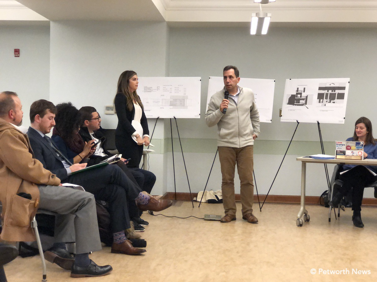 Architect and lawyer for the developer discussing the redevelopment of 4521 Iowa Avenue NW.
