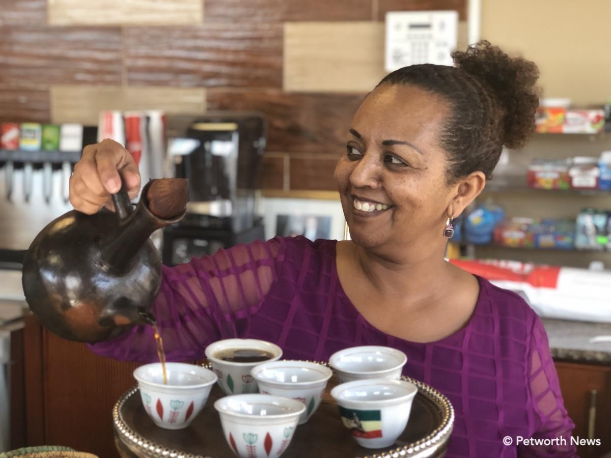 Senaite pouring the Ethiopian Coffee service.