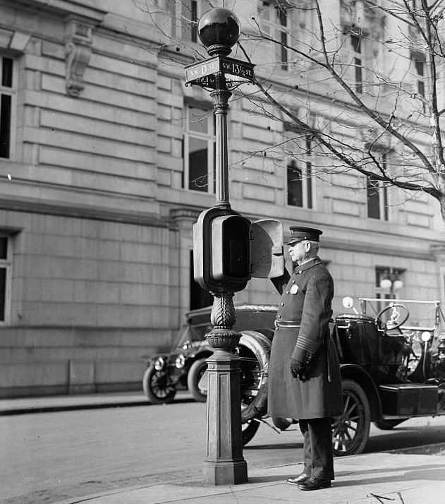 DC police officer using a call box at 13th 1/2 and D Streets NW in 1912 (wikipedia)
