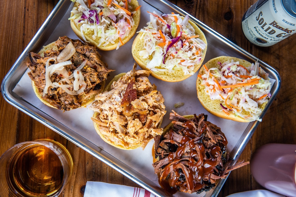 Pulled pork, pulled chicken and brisket sandwiches. (photo: Cinder BBQ)
