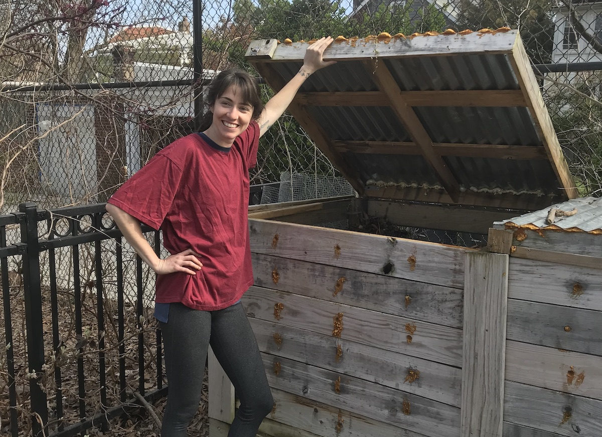 Kathleen Brophy at the compost bin