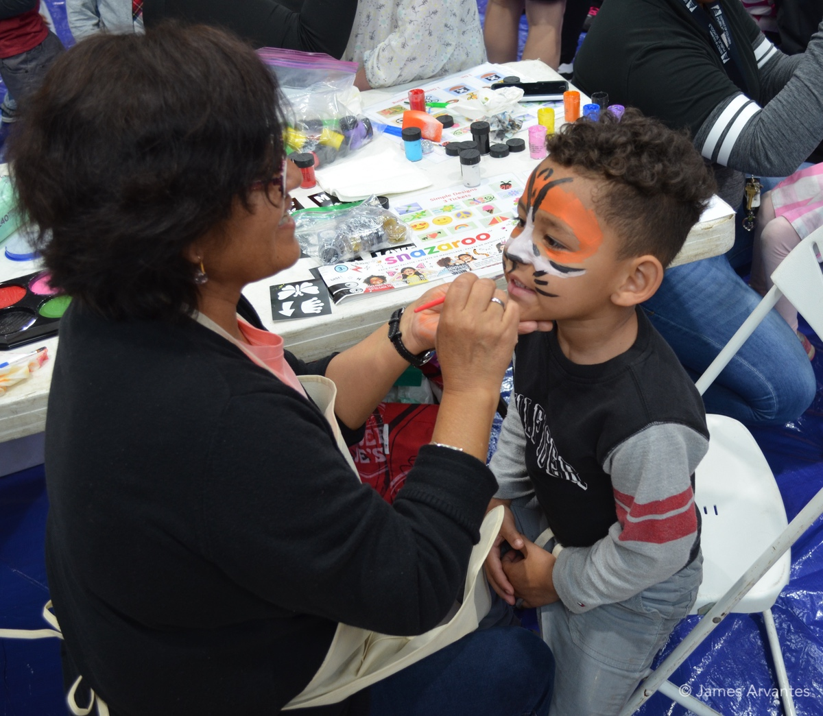 Face-painting and other activities at the Community Carnival