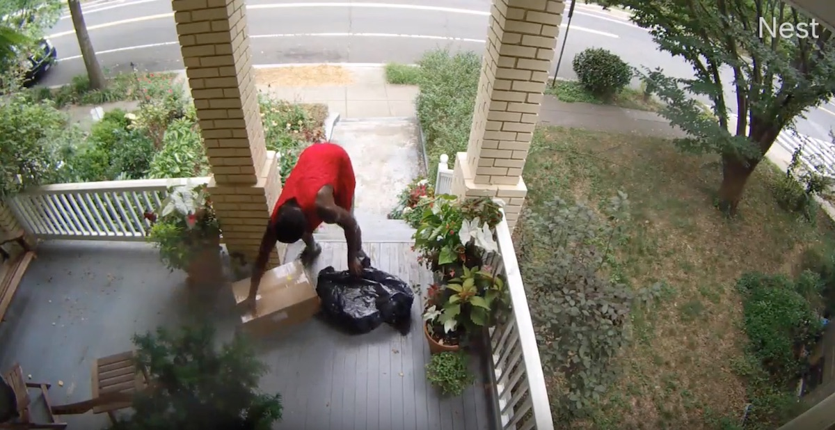A still from the video captured by a resident of a mail stealing a package from his home.