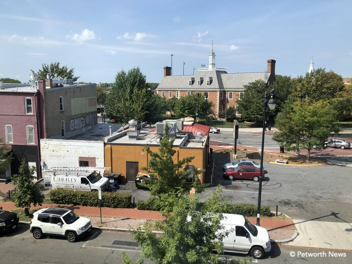 The view out the window from the second floor looking toward 9th Street with the Library in the distance. Slims on the left, the new Cigar Bar in white and PIzza Hut on the right. A mural would look good on those walls…