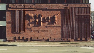 Henry Moore, Wall Relief No.1 (1955) Rotterdam  Commissioned by the Bouwcentrum  Henry Moore is best known for his abstract sculptures of figures, recognizable for their undulating lines and large, unusual proportions. Wall Relief No. 1 deviates from Moore's typical subject matter, while still remaining emblematic of his style. The relief is largely made up of geometric shapes and patterns – parallel and perpendicular lines, rectangles and circles – largely occupying the outer edges of the wall. In the center are five forms resembling Moore's usual sculptures, their soft lines and natural forms contrasting with the strict lines and angles of the work's edges. The relief took over four months to construct, and is made up of approximately 16,000 hand-carved bricks. A giant of modern sculpture, Moore engaged the abstract, the surreal, the primitive and the classical in vigorous corporeal forms that are as accessible and familiar as they are avant-garde. His large-scale works celebrate the power of organic imagery at a time when traditional representation was largely eschewed by the vanguard art establishment. Their overwhelming physicality and forceful presence promotes a charged relation between sculpture, site, and viewer.  Wall Relief No.1 was was temporarily removed in 2010 when the former Bouwcentrum (Building Centre), later named Weena Point was demolished. The work was later re-integrated into the new building facade design by De Architecten Cie and erected in the same location.  Image and text excerpts source:  http://www.itsliquid.com/henry-moore-gagosian.html https://www.sculptureinternationalrotterdam.nl/en/collectie/wall-relief-no-1-en  #henrymoore #wallrelief #sculpture #architecture #greatpublicart #publicart #facade #abstractart #abstractsculpture #rotterdam