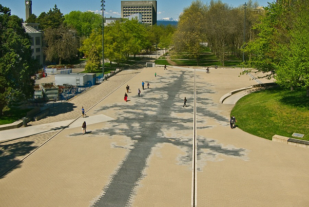 Esther Shalev-Gerz, The Shadow (2018)  Vancouver  Commissioned by UBC, Vancouver, Photograph Robert Keziere  24000 three-shade concrete pavers, 100x25m Esther Shalev-Gerz's commission The Shadow embeds the ghostly silhouette of a first-growth Douglas fir across the expanse of University Commons Plaza, which is situated on the traditional, ancestral and unceded territory of the Musqueam people. The Shadow invites to consider the scale of the trees that once existed on this site as well as the vast change that has taken place in a relatively short period of time. It establishes a dialogue between presence and absence, culture and nature, past and potential future, and through its humble invitation to a reconciliation with nature, the work meets crucial matters of our world today.  A contemporary mosaic pixilated through the use of differing shades of grey paving stones, The Shadow engages pedestrians through its varied texture and tone underfoot, offering horizontal immersive perspectives. The inauguration if The Shadow will take place this Sunday, September 16, 2018 - 2 to 4pm, University Commons Plaza, UBC Link to the event on the Belkin Art Gallery website, where you can also download the booklet about The Shadow: http://belkin.ubc.ca/events/esther-shalev-gerz-inauguration Text and photographs kind courtesy of the artist. Aerial photograph: Hassan El-Sherbiny  Two detail and front facing photographs: Robert Keziere  Artist website http://www.shalev-gerz.net/?portfolio=the-shadow  Interview with the artist https://www.nationalobserver.com/2018/09/09/features/exclusive-video-esther-shalev-gerz-talks-linda-solomon-wood-about-smoke-trees Time-lapse of the installation https://www.youtube.com/watch?v=Cr6eFy1BkXw Commissioned with support from the Burrard Arts Foundation, Rick Erickson and Donna Partridge, Brigitte and Henning Freybe, Phil Lind, the Morris and Helen Belkin Foundation, Rennie Foundation and UBC's Matching Fund for Outdoor Art through Infrastructure #esthershalevgerz #theshadow #greatpublicart #publicart #contemporaryart #pavingstones #artoftheday #artofvisuals #artoninstagram