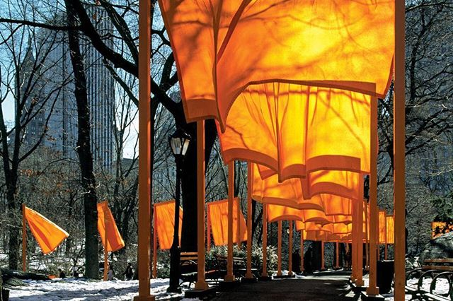 Christo and Jeanne-Claude, The Gates (1979 - 05)  Central Park, New York  The installation in Central Park was completed with the blooming of the 7,503 fabric panels on February 12, 2005. The 7,503 gates were 16 feet (4.87 meters) tall and varied in width from 5 feet 6 inches to 18 feet (1.68 to 5.48 meters) according to the 25 different widths of walkways, on 23 miles (37 kilometers) of walkways in Central Park. The gates and the fabric panels could be seen from far away through the leafless branches of the trees. The work of art remained for 16 days, then the gates were removed and the materials recycled.  The grid pattern of the city blocks surrounding Central Park was reflected in the rectangular structure of the commanding saffron colored poles while the serpentine design of the walkways and the organic forms of the bare branches of the trees were mirrored in the continuously changing rounded and sensual movements of the free-flowing fabric panels in the wind. The people of New York continued to use the park as usual. For those who walked through The Gates, the saffron colored fabric was a golden ceiling creating warm shadows. When seen from the buildings surrounding Central Park, The Gates seemed like a golden river appearing and disappearing through the bare branches of the trees and highlighting the shape of the meandering footpaths. The Gates was entirely financed by Christo and Jeanne-Claude, as they have done for all their previous projects. The artists do not accept sponsorship or donations. Chief Engineer and Director of Construction: Vince Davenport Project Director: Jonita Davenport Photographer: Wolfgang Volz  Image and text source http://christojeanneclaude.net/mobile/projects?p=the-gates  #thegates #christoandjeanneclaude #greatpublicart #publicart #centralpark #newyork #outdoorart #contemporaryart #artofvisuals #artoftheday #artofinstagram