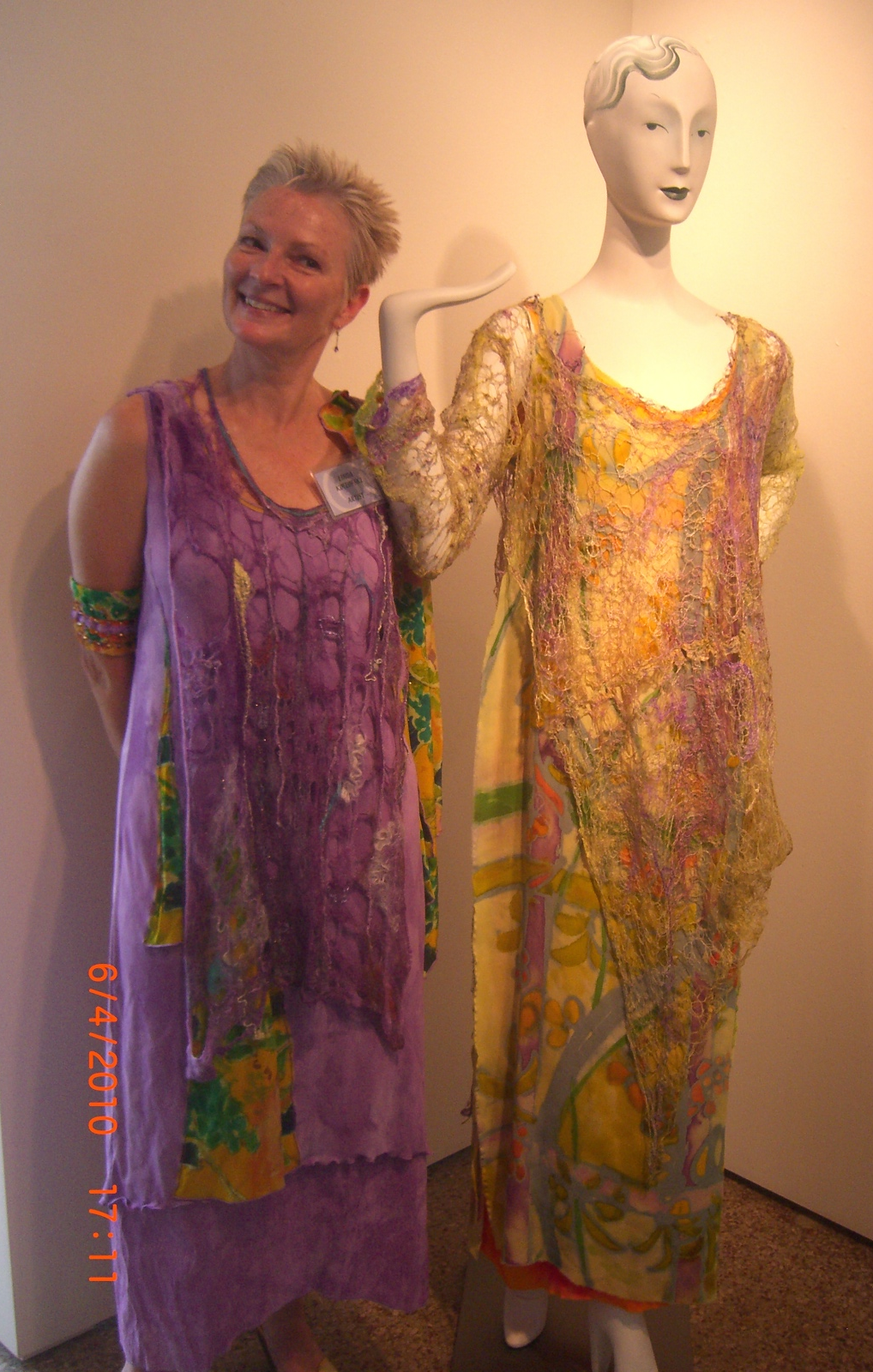 """This is me at my first juried show in 2010, 'Inside Out', with my piece """"Inner Journey Soul Image'. This exhibition featured works of art that covered the physical form, yet revealed the soul of the artist. These pieces were hand painted, hand felted, and machine embroidered."""