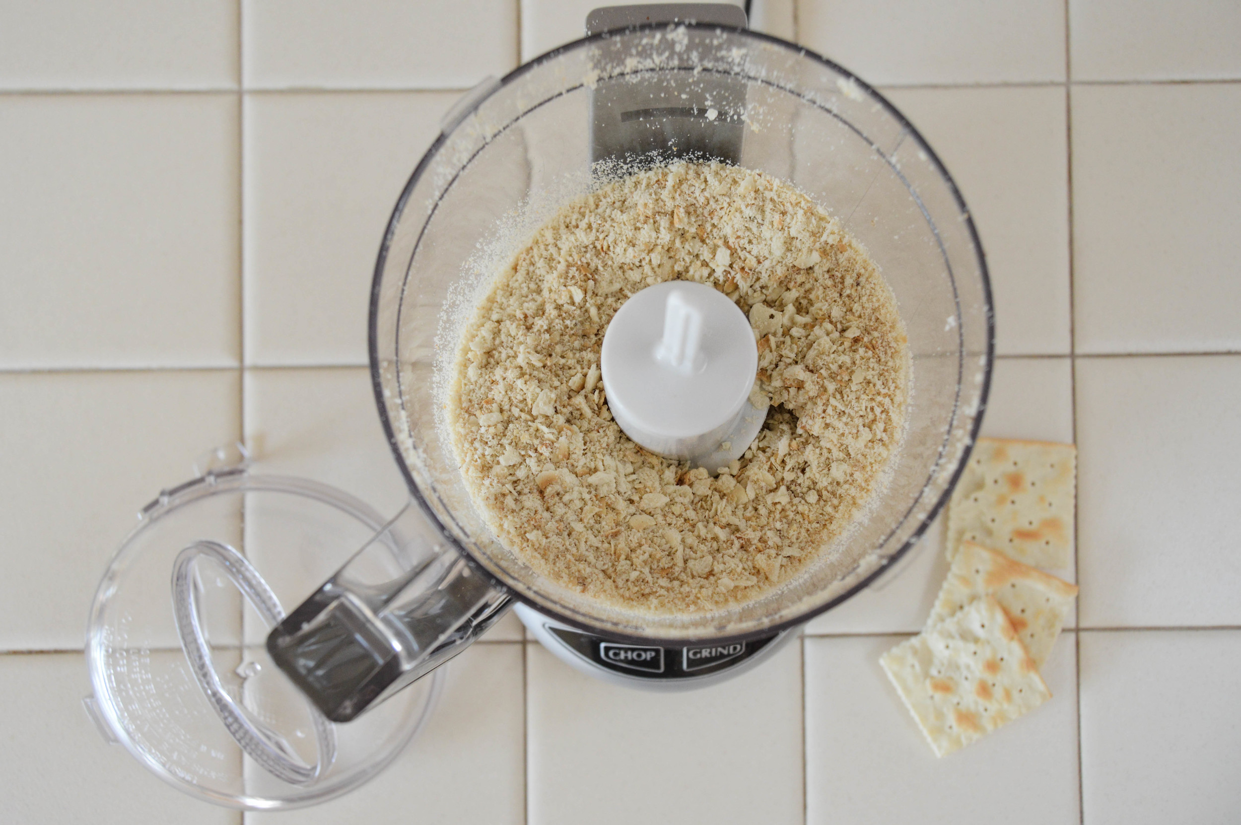 Chop crackers into fine crumbs. Set aside. Repeat with walnuts. If you do not have a food processor, crush crackers in a zip lock bag with rolling pin and finely chop nuts with a knife.