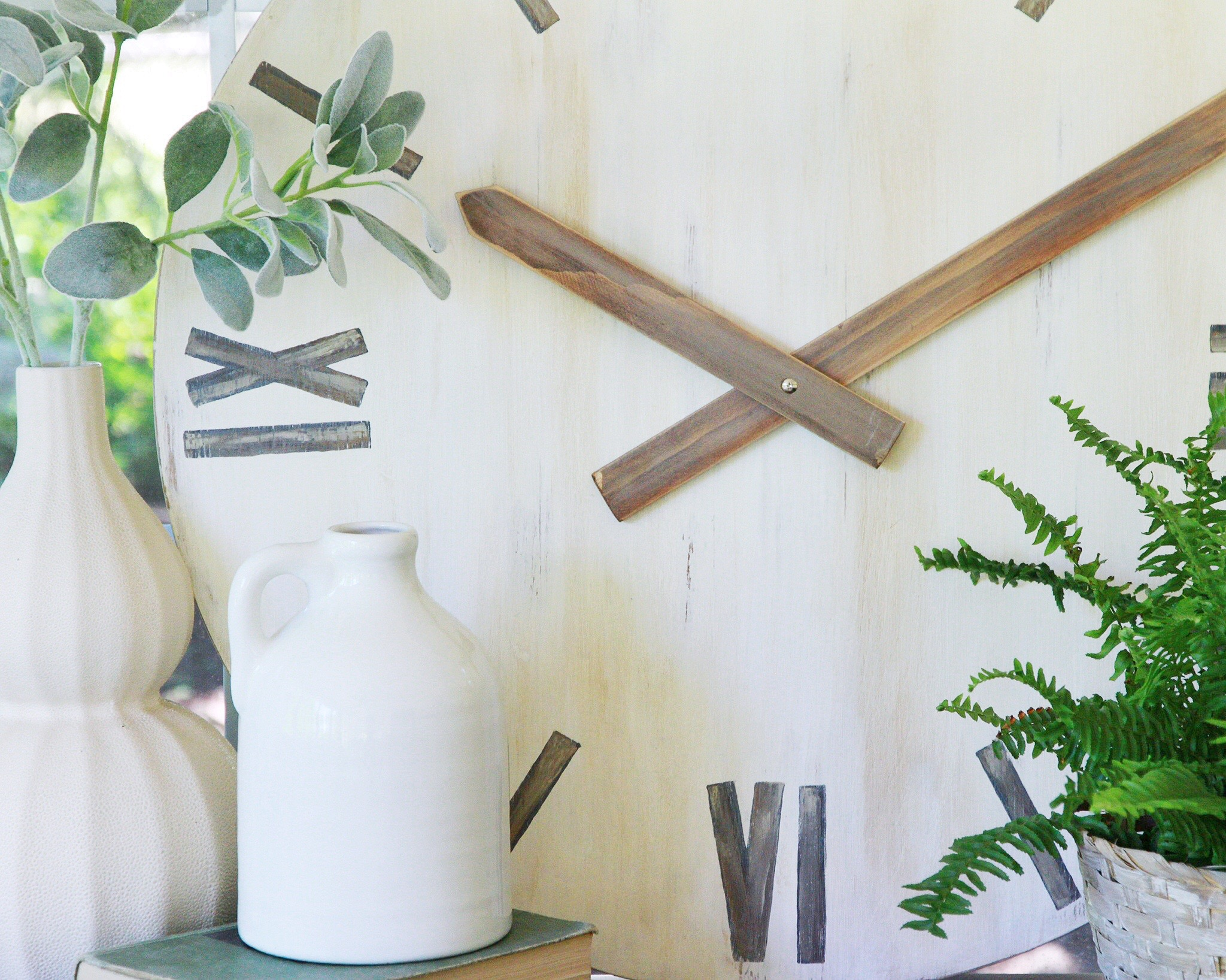 An old thrifted table top transformed into a decorative clock