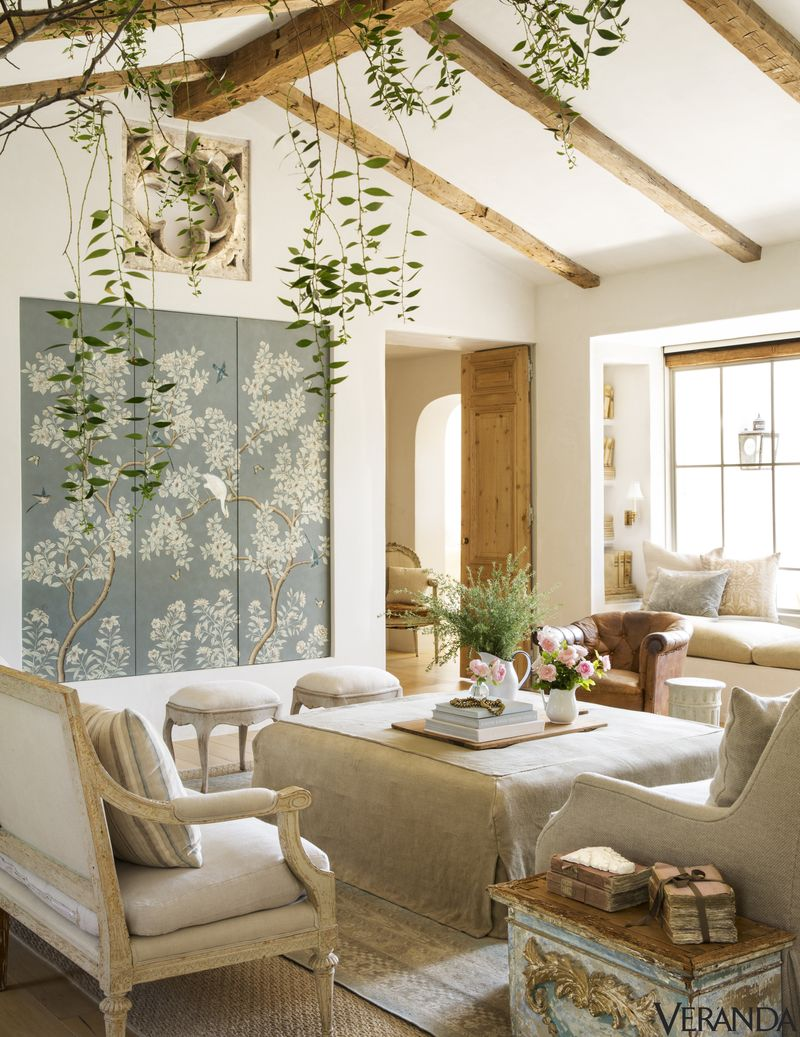 5 | Indoor Vines - Designer Brooke GIanetti does it again - These simple vines draped over exposed beams and trailing down to eye level give this living room an airy and organic feel.