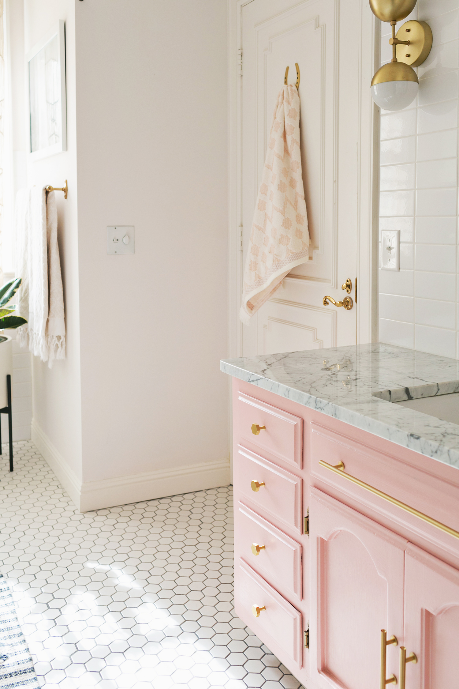 1 | Millennial Pink - This girly bathroom makeover has us drooling! Click on the image to see more before and after photos.