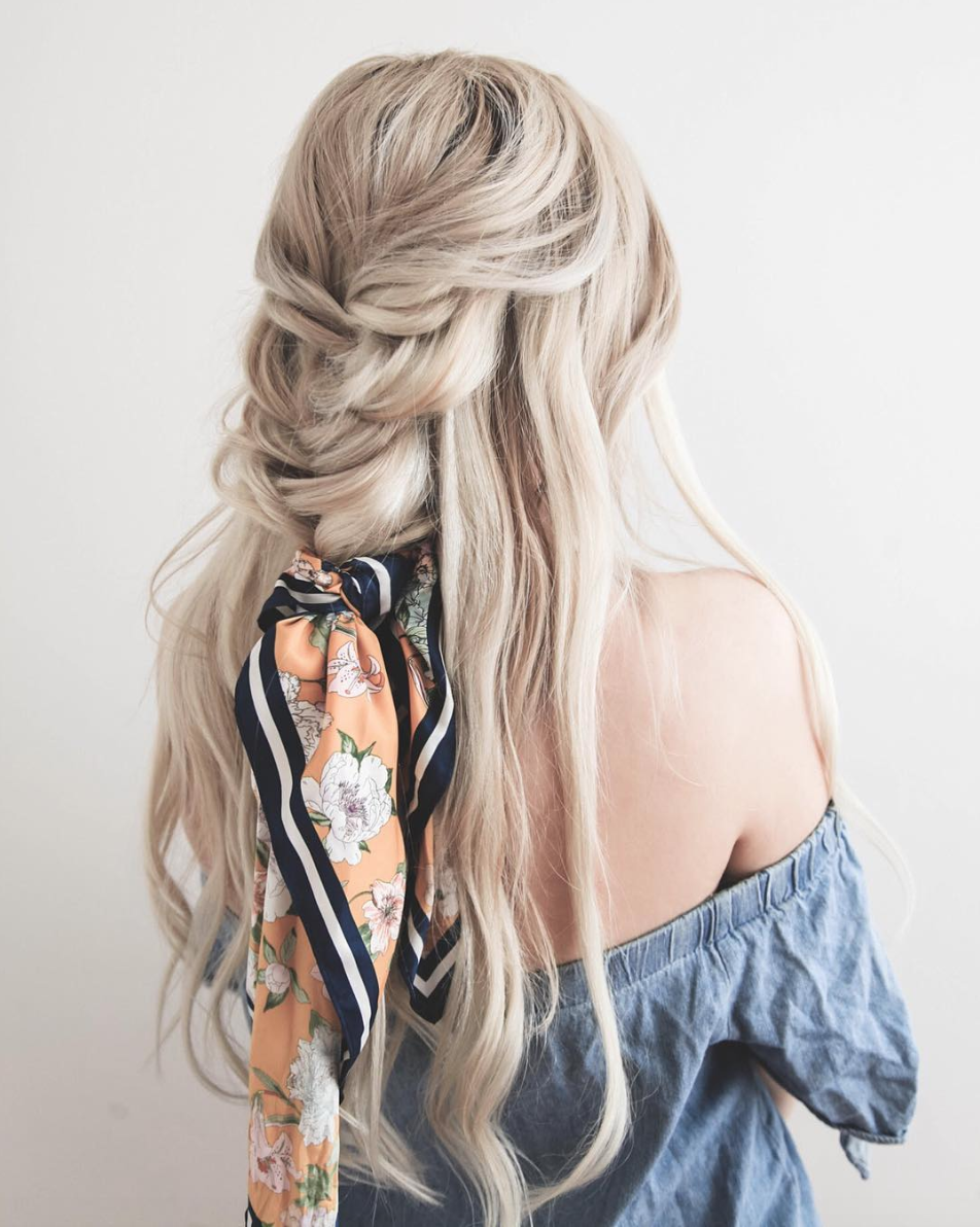 Loose Braid with Scarf - The easiest way to give your hairstyle that boho-ethereal look is to add a scarf. Here, a very loose half braid ends in a fluffy knot of a silk scarf, cascading over messy waves