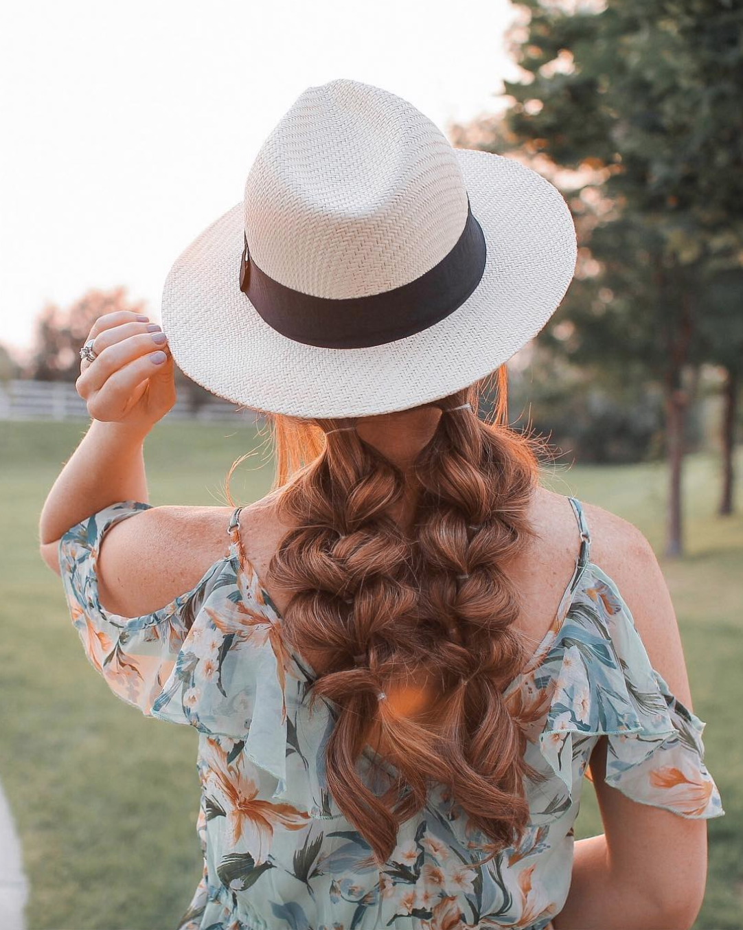 Pulled Through Pigtail braids with hat - This look is perfection for fall! Tie two basic pigtails, braid both sides and pull the hair out for volume, and finish the look with a felt or straw hat.