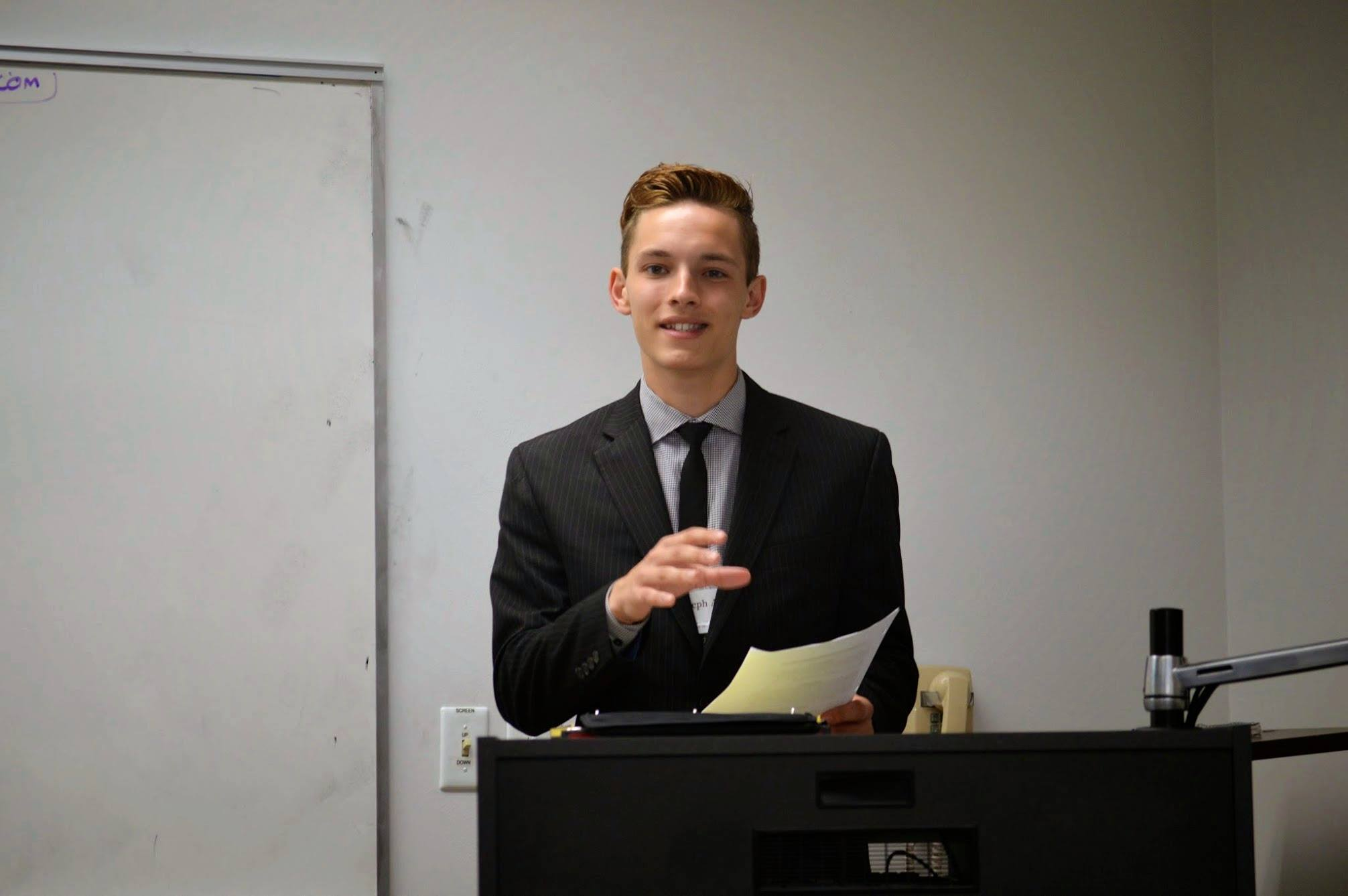 Joseph debating an LD round at Stoa Nationals during his novice year.