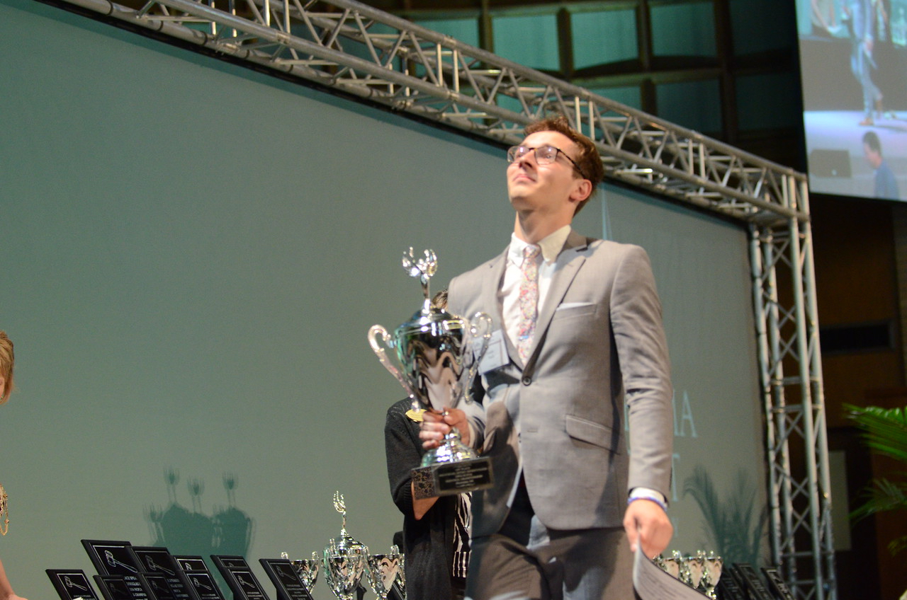 Joseph holds back tears as he accepts the Sweepstakes trophy on stage.