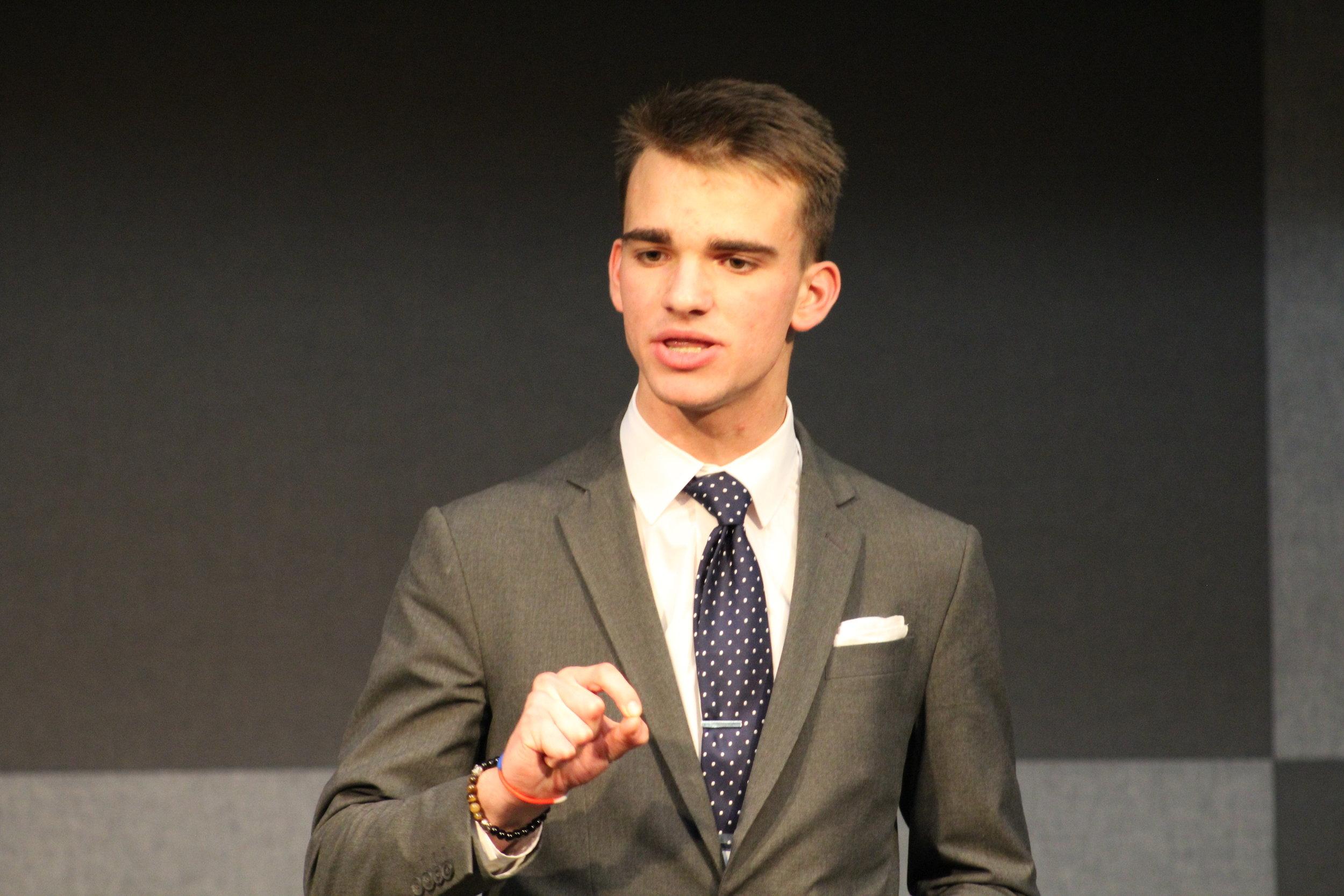 Drew speaking during a high-powered prelim round.