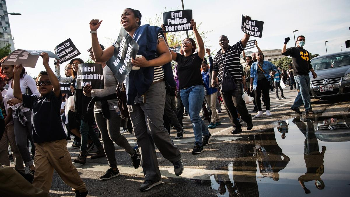 Protesters march on April 30 from Baltimore's Sandtown neighborhood to City Hall, demanding better police accountability and racial equality following the death of Freddie Gray. (Andrew Burton / Getty Images)