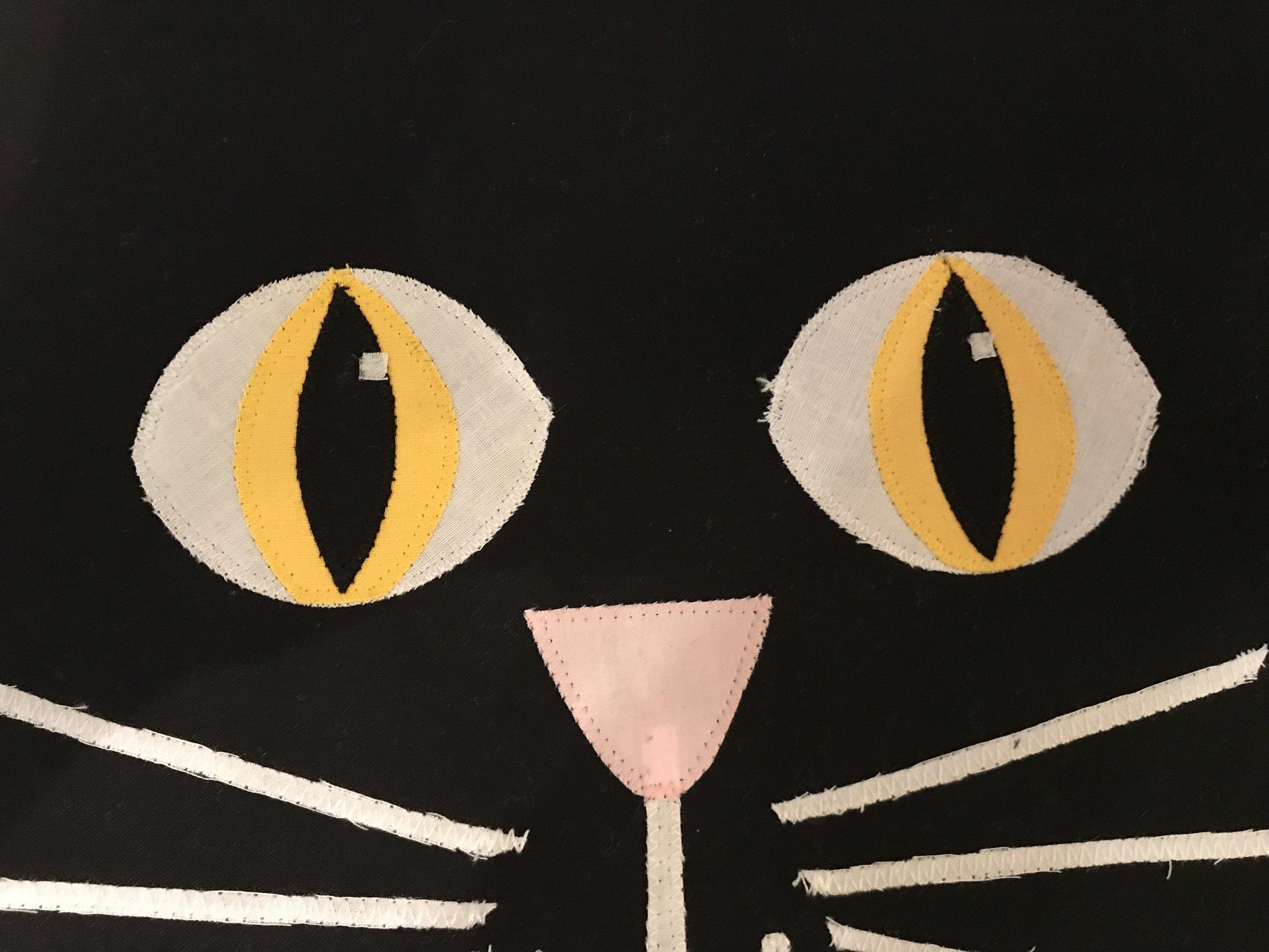 black pupil, white highlight