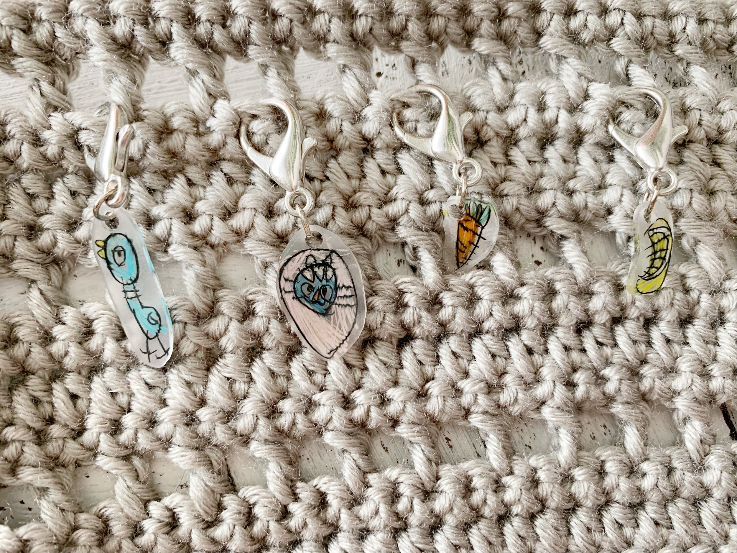My kid's drawings turned into stitch markers.