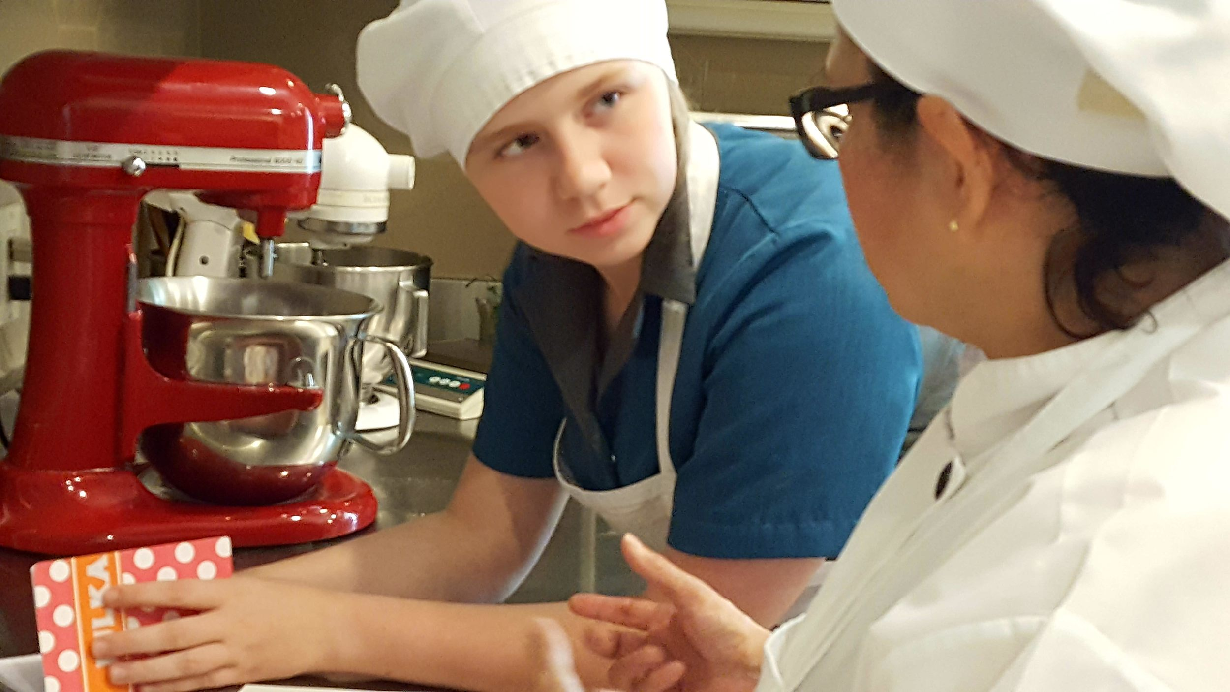 Julka settles in with baking instructor Gabriela.