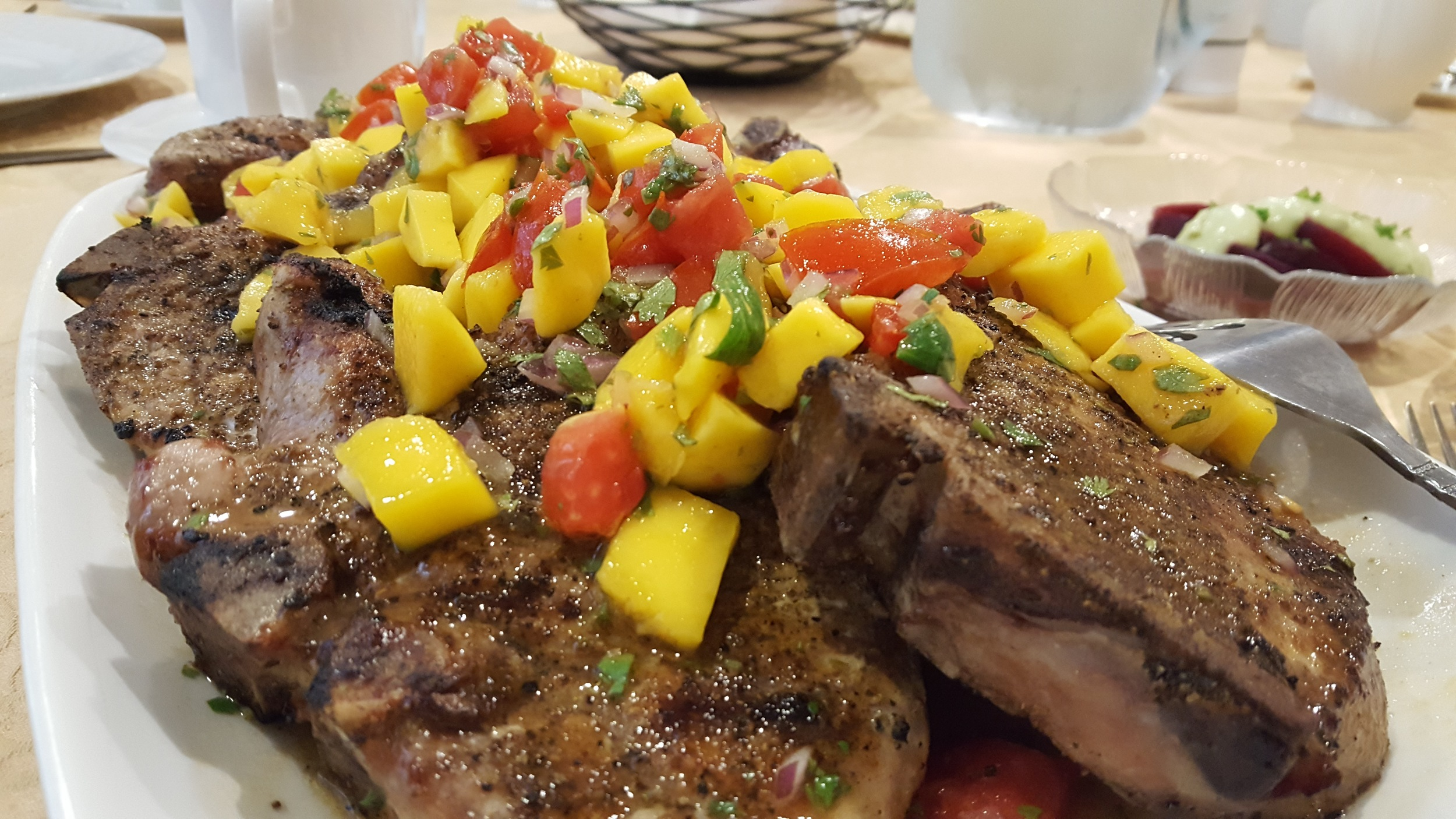 Grilled chops with mango salsa
