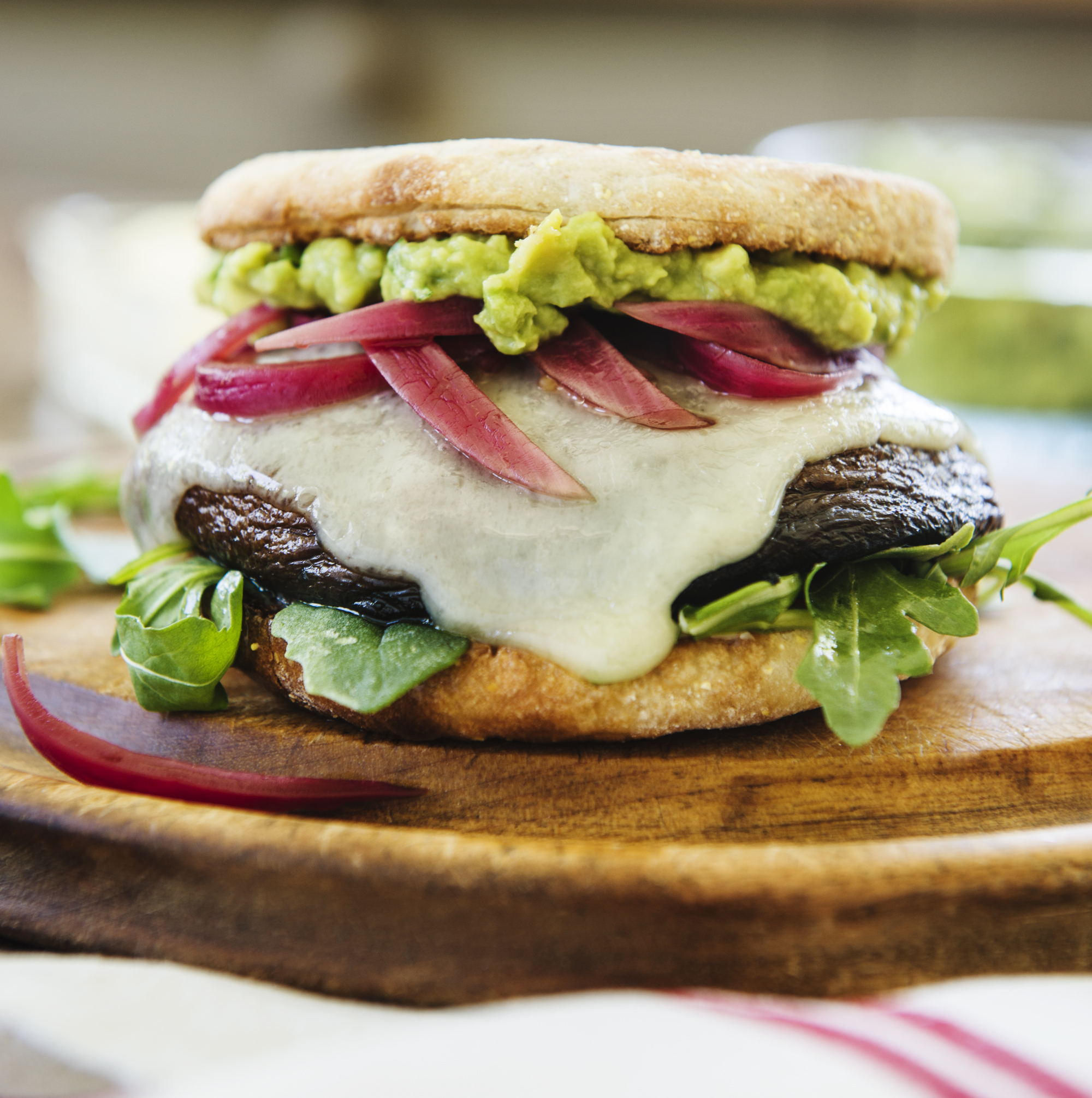 First we must gather the  Burger Build Components,  some of which we can make ourselves. The recipes make 12 servings, but you can adjust the numbers for your own party needs.  · Portobello Mushrooms Caps-3-4 inch diameter by 1-2 inch high  · English Muffins  · Plu gras butter – softened at room temperature  · Baby Arugula Lettuce  · Havarti Cheese Slices  · Pickled Red Onions  · Avocado Herb Mash  You will want to make the Pickled Red Onions first, to give them time to rest and cool before they are called for their close-ups.