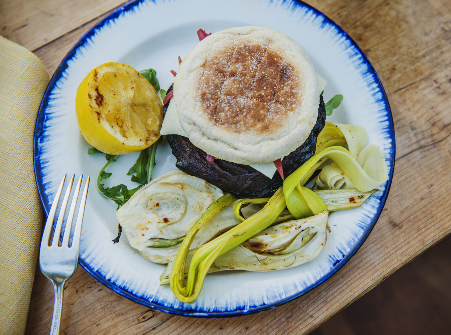 Overhead Portobello Burger and Grilled Fennel Leeks and Presrved Lemon on plate smaller.jpg